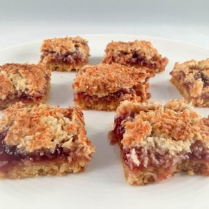 This Raspberry Coconut Slice Recipe is perfect for a quick and easy snack. The coconut slice taste excellent and can be made with any jam flavour... | AmateurChef.co.uk