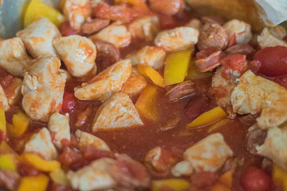 Chicken and Chorizo pasta bake step with tomatoe   amateurchef.co.uk